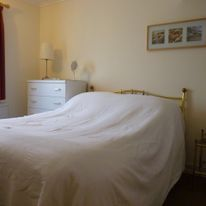 The double bedroom: also light and airy, the rear bedroom has a double bed, plenty of wardrobe space and drawers